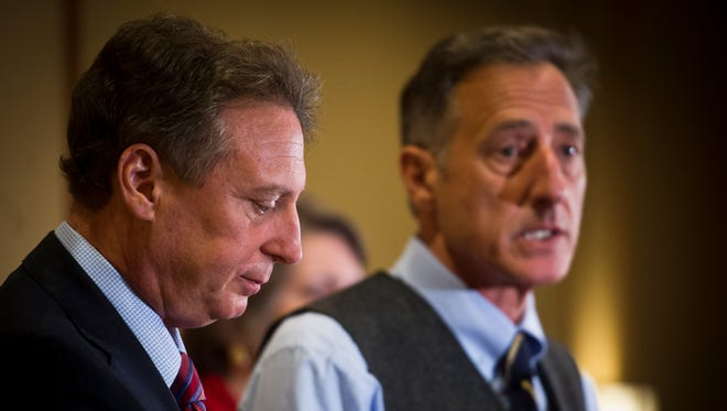 From left, Michael Goldberg, a court-appointed lawyer who now is effectively  in charge of all operations at both Jay Peak and Burke, holds a news conference with Gov. Peter Shumlin at Hotel Jay in April 2016.