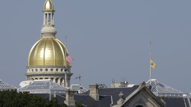 Flags fly at half-staff over the State House in Trenton in 2013. (AP Photo/Mel Evans)