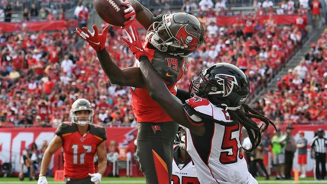 From Dec. 29, 2019, Tampa Bay Buccaneers wide receiver Breshad Perriman (19) pulls in a 24-yard touchdown reception in front of Atlanta Falcons outside linebacker De'Vondre Campbell (59) during the first half of an NFL football game in Tampa, Fla. Perriman agreed to terms Tuesday with the New York Jets on a one-year deal worth up to $8 million and includes $6 million guaranteed, agent Drew Rosenhaus told The Associated Press.