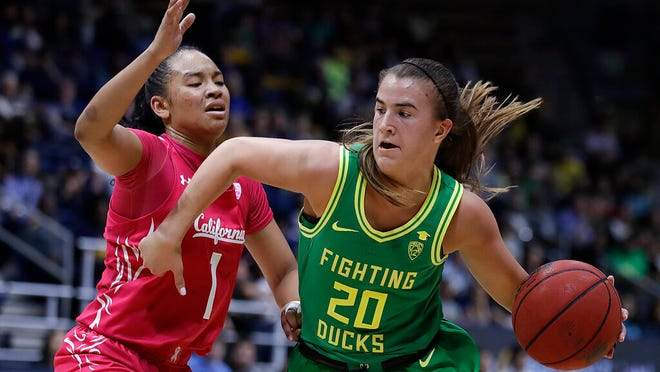 Oregon's Sabrina Ionescu, right, drives as California's Leilani McIntosh (1) defends during the second half of an NCAA college basketball game Friday, Feb. 21, 2020, in Berkeley, Calif.