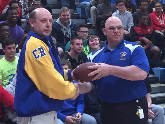 Both retired coach Mike Schonewolf (left) and current coach Dan Candeloro guided the high school career of Patriots safety Duron Harmon at Caesar Rodney. Candeloro believes the Eagles must rush the passer well to win the Super Bowl on Sunday.