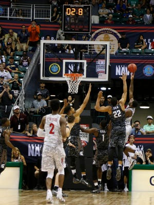 Nov 11, 2016; Honolulu, HI, USA; Wildcats guard Kadeem Allen (5) makes the winning basket with under 3 seconds to go in the game against the Spartans at the Stan Sheriff Center.  Arizona defeats Michigan State 65-63.