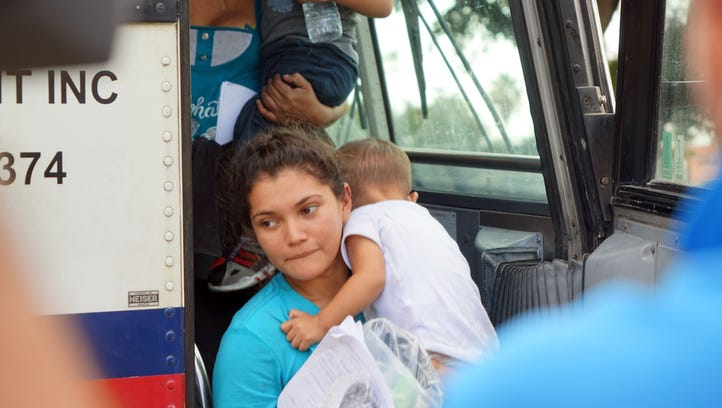 Migrants released from federal custody exit a bus after