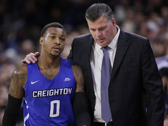 In this Dec. 1, 2017, file photo, Creighton coach Greg McDermott, right, speaks with guard Marcus Foster a game against Gonzaga in Spokane, Wash. McDermott's high-risk decision to bring in Foster as a transfer three years ago has been highly rewarding for himself, Foster and the program.