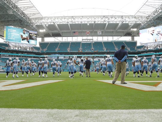 Tennessee Titans warm up under a new roof at the Hard Rock Stadium before an NFL preseason football game against the Miami Dolphins, Thursday, Sept. 1, 2016 in Miami Gardens, Fla. (AP Photo/Lynne Sladky)