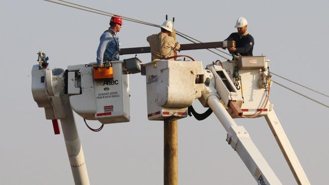 "Maybe Glen Campbell was singing about these gentlemen, in his song ""Wichita Linemen"". Actually, they are employees of ComEd putting up powerlines along Old Route 66 between Pontiac and Chenoa Friday morning. The song was recorded in 1968."