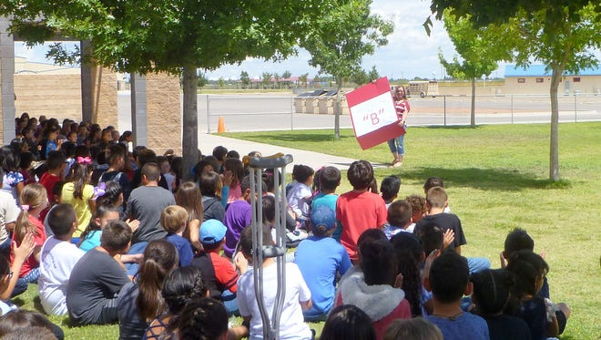 """Bataan Elementary School Principal Ivy Bacagathered with her third-, fourth and fifth-grade students to share the letter grade that Bataan earned from the New Mexico Public Education Department. Baca praised the students and staff for earning a """"B."""" When asked what they wanted to earn next year, the students yelled, """"A."""" Baca let all of the students enjoy an extra recess and a bag of popcorn and the staff enjoyed a break with refreshments."""