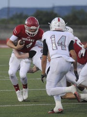 Jim Ned quarterback Coalby Rives (14) is tackled during the Indians' 32-28 loss to Sonora on Friday at Indian Stadium.