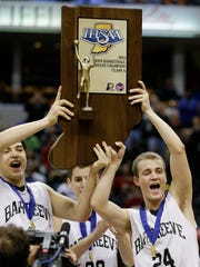 Barr-Reeve's Addison Wagler (left) and Trevor Yoder hold up the championship trophy after defeating Marquette Catholic, 65-50, for the IHSAA Class A championship.
