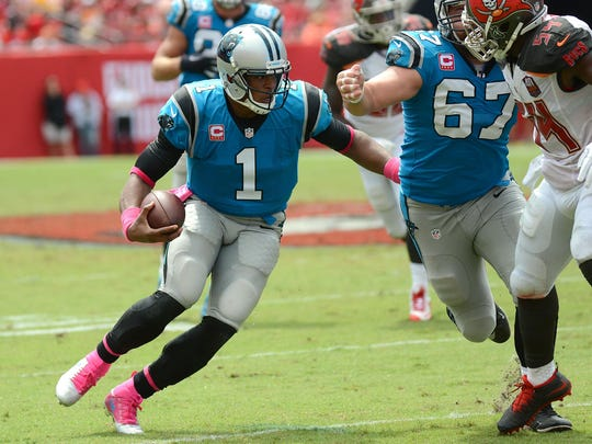 Oct 4, 2015; Tampa, FL, USA; Carolina Panthers quarterback Cam Newton (1) runs in the first half against the Tampa Bay Buccaneers at Raymond James Stadium. Mandatory Credit: Jonathan Dyer-USA TODAY Sports