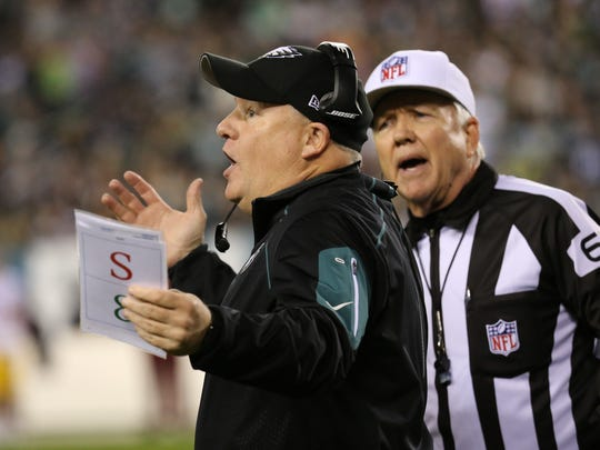Eagles coach Chip Kelly argues a call at the end of the first half.