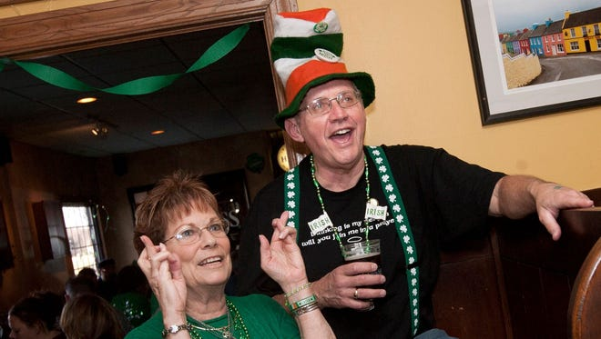 Ginny Sandroni and Mike Conley celebrate St. Paddy's Day at O'Donoghue's Irish Pub in 2012. O'Donoghue's will once again have a full slate of festive fun available for guests for this year's holiday on March 17.