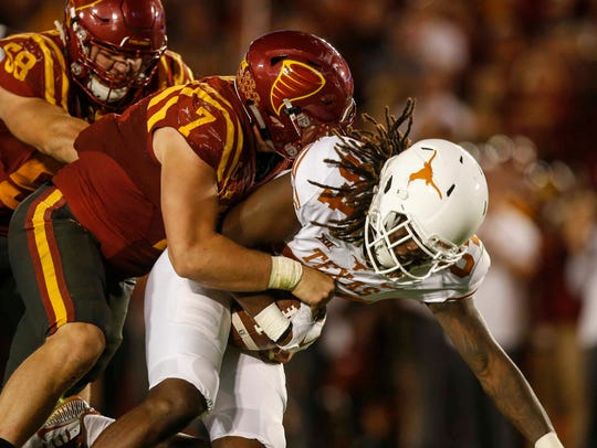 Iowa State linebacker Joel Lanning tackles Texas receiver
