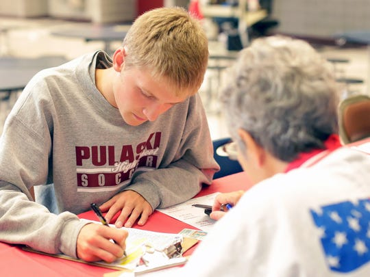 Pulaski High School senior Alec Bukowiec registers