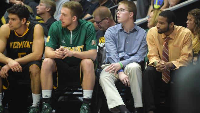 Columbus North senior  Josh Speidel sits on the end of the bench with the Vermont team Sunday, November 15th, 2015 at Mackey Arena in West Lafayette. Speidel was involved in a serious car crash last Sunday.