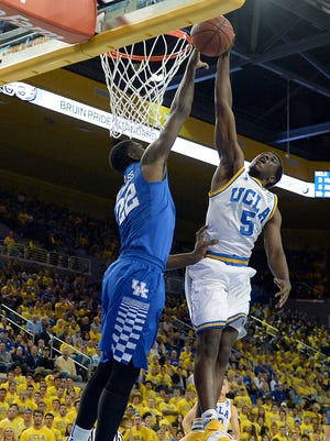 UCLA Bruins guard Prince Ali (5) dunks the ball against Kentucky Wildcats forward Alex Poythress (22) during the second half at Pauley Pavilion.