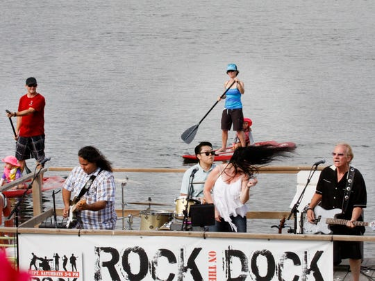 Carmen and the Renegade Vigilantes perform from a floating dock during the Rock the Dock concert series that started Saturday at Ventura Harbor Village. Music lovers can watch bands from a variety of angles at the water venue on Saturdays in September.