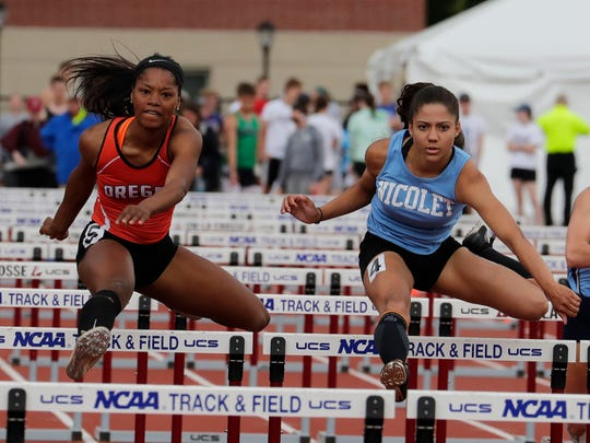 Destiny Haven (right) of  Nicolet stays just ahead of Oregon's Alexis Jackson to to win the girl's 100-meter high hurdle crown by 0.07 seconds in Division 1 on Saturday.