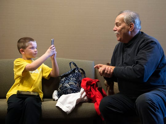 Gabriel Doyle, 7, takes a photo of his grandfather John Butler in the hallway of Knoxville Orthopedic Clinic on Thursday, Feb. 2, 2017. Gabriel has scoliosis and is the first to be treated in East Tennessee with the MAGEC system.