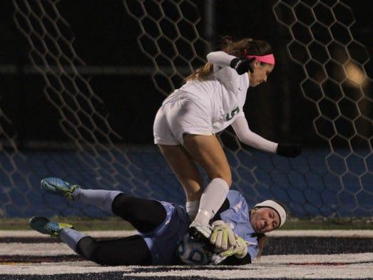 Northern Highlands goalie Kayla Klatt pulls in ball