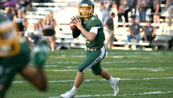Christ School's Drew Johnson throws the ball during