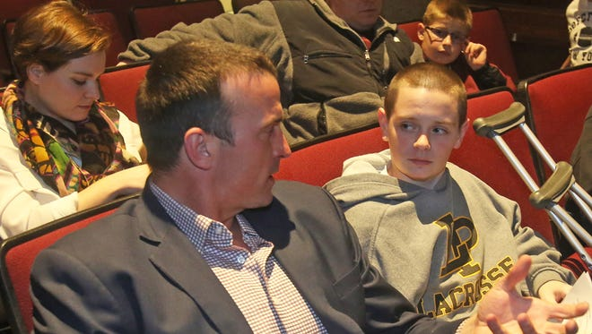 Former NBA player Chris Herren speaks with Bobby Noble, 14, of Mahopac before speaking to students and adults at Lakeland High School in Shrub Oak Feb. 26, 2014. Herren's basketball career ended because of his addiction to drugs. He now travels the country speaking to students and sharing his story.