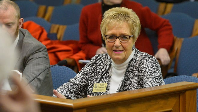 State Rep. Kathy Crawford testifies about a bill before a Senate committee.