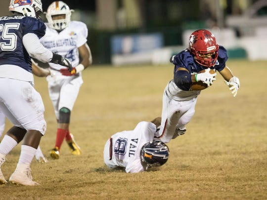 Joe Wilkins of North All-Star team hauls in a catch during the Rotary South All-Star game at Fort Myers High School.
