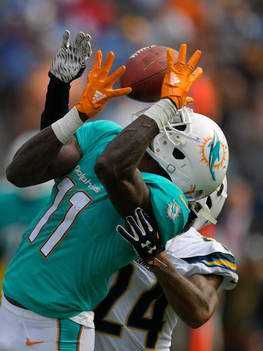 Miami Dolphins wide receiver DeVante Parker (11) hauls in a pass as Los Angeles Chargers cornerback Trevor Williams defends during the second half of an NFL football game Sunday, Sept. 17, 2017, in Carson, Calif. (AP Photo/Mark J. Terrill)
