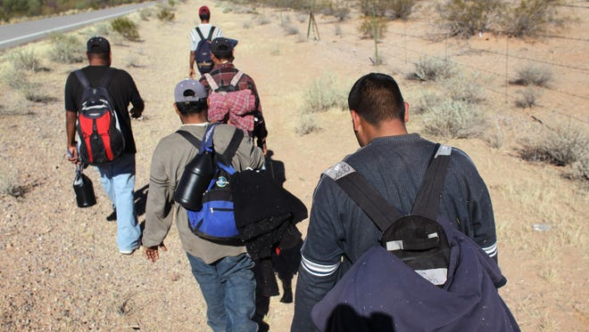 Undocumented Mexican immigrants walk through the Sonoran Desert in 2011 after crossing the U.S.-Mexico border border.