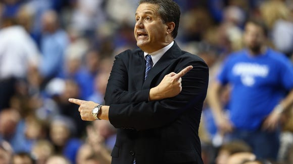 UK head coach John Calipari instructs his team during the Cats' November 2013 game against Cleveland State.