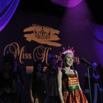 Katelyn Stone of Ellisville introduces herself during the Parade of Contestants portion at dress rehearsal for the Miss Hospitality Pageant at the Saenger Theater on Thursday. Miss Hospitality contestants will attend the Community Autograph Party at the Hattiesburg Zoo from 12:30 to 1:30 p.m. today, with the preliminary competition beginning at 8 p.m.