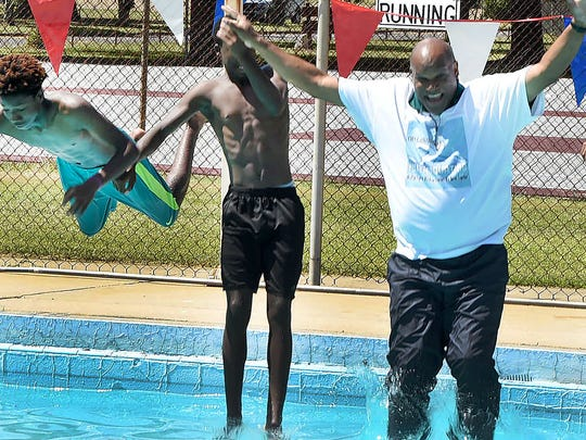 Mayor Reggie Tatum cools off by taking a dip in the swimming pool at North City Park.