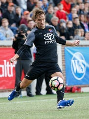 FC Cincinnati defender Matt Bahner (2) delivers a cross in the first half during the USL soccer game between Louisville City FC and FC Cincinnati, Saturday, April 22, 2017, at Great American Ball Park in Cincinnati.