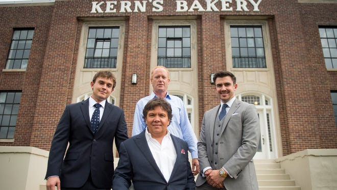 Oliver Smith, bottom center, is pictured with, from left, Chad Turner, Peter Medlyn and Will Sims, outside of the Kern's Bakery Building on Chapman Highway in Knoxville. Plans call for the 70,000-square-foot building to be turned into a restaurant and entertainment center.