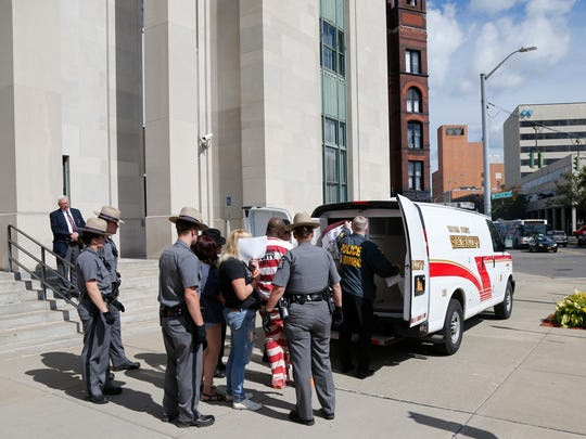 Following Wednesday's drug raids, defendants are brought out of federal court in Binghamton on September 20, 2017.
