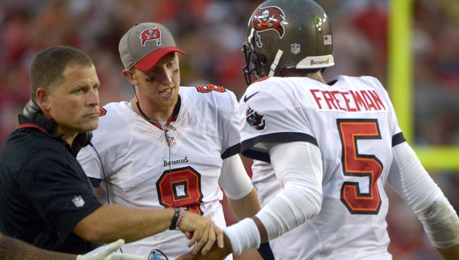 With Josh Freeman, right, out as the Bucs' starting QB and Mike Glennon, middle, taking over the role, there is no time for Tampa Bay coach Greg Schiano to look back now.