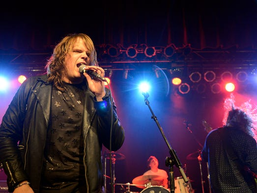 Thousands of fans lined the streets Saturday to get a glimpse of American Idol star Caleb Johnson. Johnson was honored with a hometown celebration during which he and his band performed to hundreds of screaming fans at the Orange Peel. 5/10/14. Robert Bradley