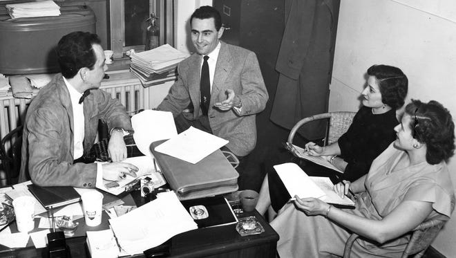 """Director-producer Bob Huber (left) discusses an episode for WKRC-TV's """"The Storm"""" with writer Rod Serling, costume designer Dorothy Revelos and set designer Pat Thomas in January 1952."""