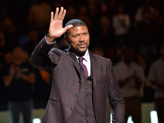 Former Michigan basketball player Jalen Rose receives