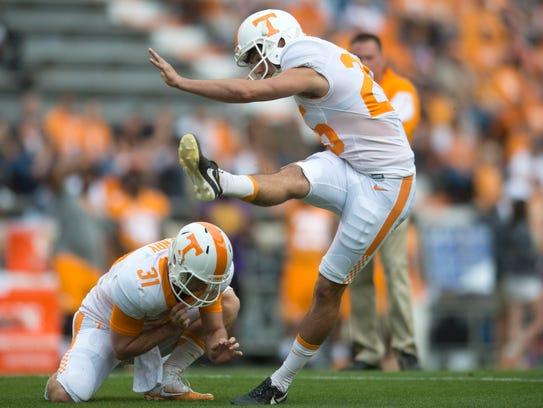 Placekicker Aaron Medley (25) kicks the ball during