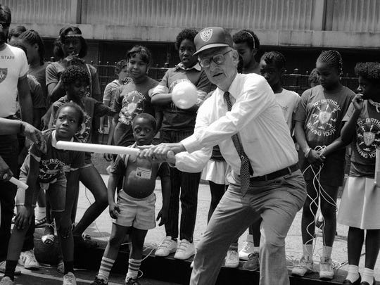 Robert Morgenthau, president of the Police Athletic League and New York County district attorney, swings at the ball at the launching of PAL?s festival of city games in New York on Tuesday, July 9, 1985. (AP Photo/Marty Lederhandler)