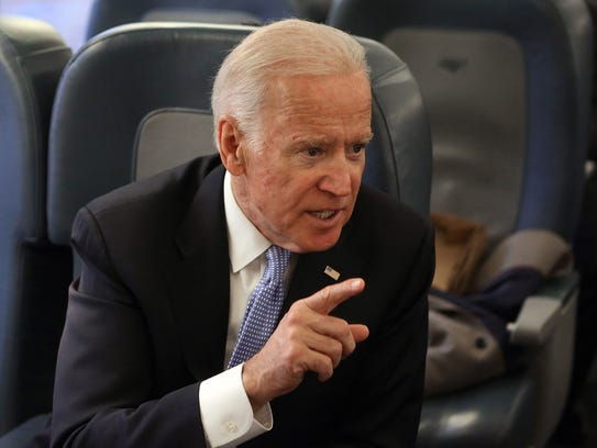 Former vice president Joe Biden chats with colleagues