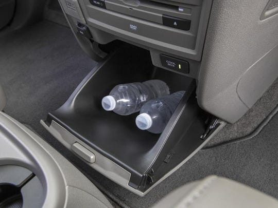 The 2014 Honda Odyssey features refrigerated compartment for juice boxes and water.