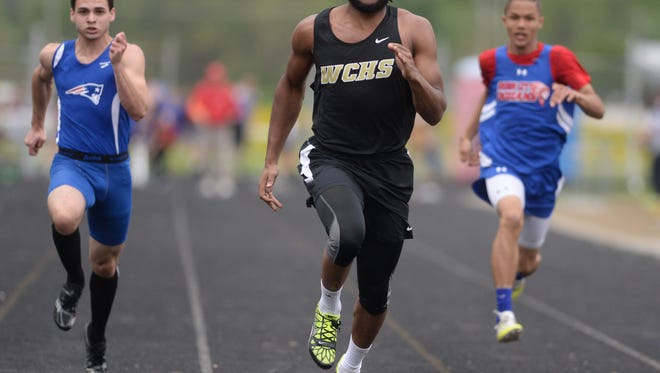 Winchester's Kiante Enis, center, runs the 100m dash Thursday, May 12, 2016 in the TEC track and field meet in Hagerstown.