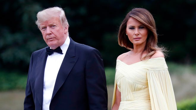 President Donald Trump and first lady Melania Trump leave Winfield House, residence of the U.S. ambassador in London, before boarding Marine One helicopter for the flight to their dinner at Blenheim Palace.