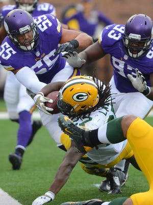 Green Bay Packers running back Eddie Lacy (27) bounces off tacklers and falls onto the goal line for a touchdown in the fourth quarter against the Minnesota Vikings at TCF Bank Stadium November 23, 2014.