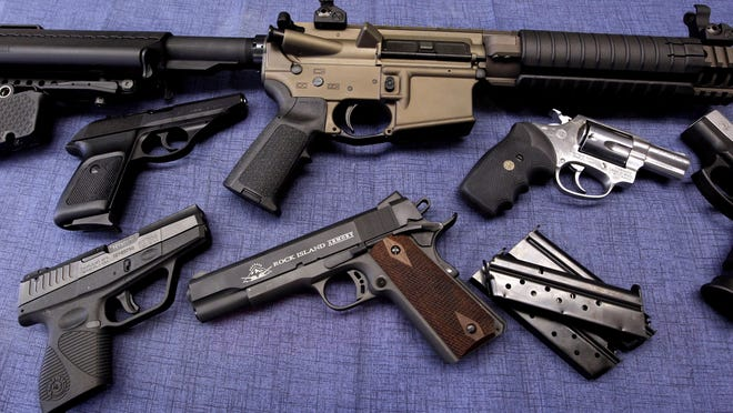 An array of guns is shown at Ron's Pawn and Gun in Des Moines in 2013.