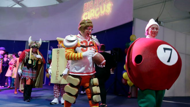 "Several Clown Captains work with other volunteers, Macy's employees and Big Apple Circus clowns, at ""Clown U."" under the the Big Apple Circus tent in New York's Lincoln Center on  Nov. 15, 2014."