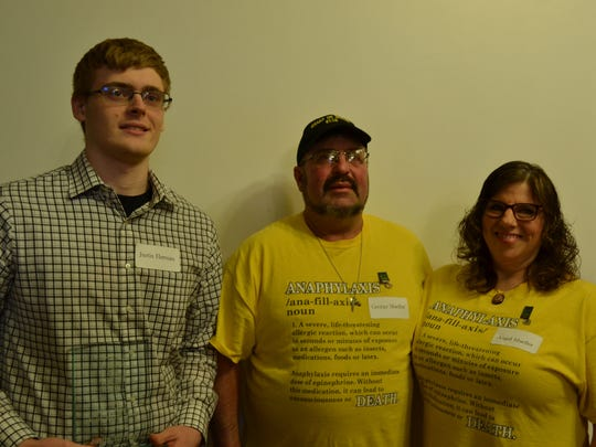 The Dillon Mueller Youth Service Award was presented to Justin Herman. Pictured are Justin Herman and George and Angel Mueller, Dillon's parents.